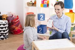 Child counselor and ADHD girl Stock Image