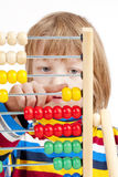 Child Counting on Colorful Wooden Abacus Stock Images