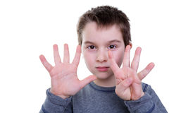 Child counting with eight fingers Stock Photography
