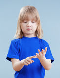 Child counting on fingers Stock Image