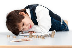Child counting money. With a worried look Stock Image