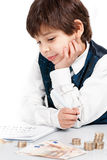 Child counting money. And taking notes Royalty Free Stock Images