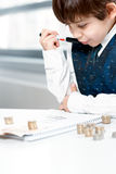 Child counting money. And taking notes. Selective focus on notebook Royalty Free Stock Images