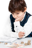 Child counting money. And taking notes Stock Photo