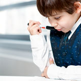 Child counting money. And taking notes Stock Photography