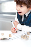 Child counting money. And taking notes. Selective focus on the notebook Stock Photos