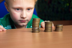 Child counting money Stock Images