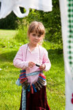 Child in countryside. Young cute girl in countryside, Washday Royalty Free Stock Image