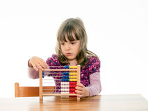Child counts with abacus Stock Images