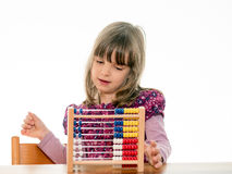 Child counts with abacus Royalty Free Stock Image