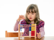 Child counts with abacus Stock Photo