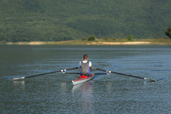 Child in the course of rowing on single stock images