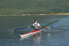 Child in the course of rowing on single Stock Photo