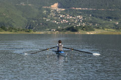 Child in the course of rowing on single Royalty Free Stock Photography