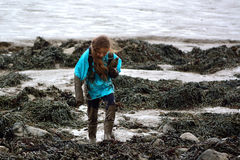 Child covered in mud on the seaside Royalty Free Stock Image