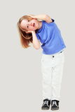 Child covering ears Royalty Free Stock Image