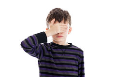 Child covering eyes Stock Photo