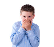 Child covering his mouth Royalty Free Stock Photography