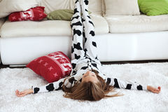 Child in cow print pajamas Royalty Free Stock Image