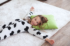 Child in cow print pajamas Stock Photo