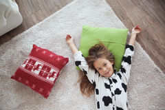 Child in cow print pajamas Stock Image
