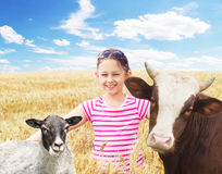 Child and a cow and a sheep Stock Photos