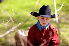 Child in cowboy hat. Portrait of cute young baby boy in cowboy hat, countryside background Royalty Free Stock Photos