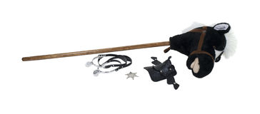 Child Cowboy Kit. Including spurs, sheriff star, saddle and a hobby horse - path included Royalty Free Stock Photography