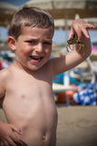 Child with crab Royalty Free Stock Photos