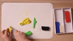 Child crafts molded from clay for sculpting on the board, accelerated, close-up stock video