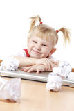 Child with crampled sheets of paper Royalty Free Stock Photo