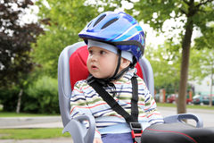 Child and crash helmet. Child sitting by bicycle in crash helmet Royalty Free Stock Image