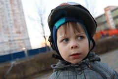 Child with crash helmet Royalty Free Stock Image