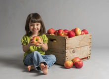 Child with crate of apples Stock Photography