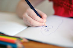 Child and crayons. Child draws with crayons in the album Stock Photos