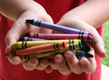 Child and crayons. Child with a handful of crayons stock photography