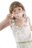 Child Creating Bubbles Stock Images