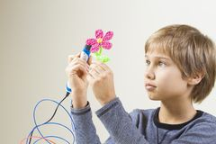 Child creating with 3D pen stock images