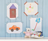 Child creativity. Funny colorful child pictures on the wall in the room Royalty Free Stock Images