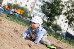Child creeping in sandbox Stock Photography