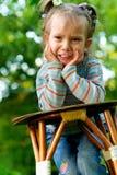 Child cries. Little girl cries against summer green garden Stock Photography