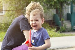 The child cries from insult. Mum regrets the son, calms down Royalty Free Stock Photography