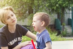The child cries from insult. Mum regrets the son, calms down Royalty Free Stock Images