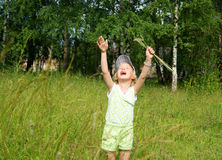 Child cries at meadow Stock Photos