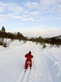 Child cross country skiing. Little child long distance cross country skiing alone in a winter landscape Stock Images