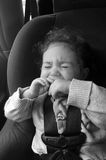 Child cry in a car seat Royalty Free Stock Images