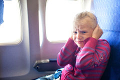 Child crying in the airplane Stock Image