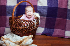 Child is crying in the basket Stock Photo