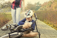 Child crying after falling from bicycle Stock Images