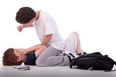Child crying on floor child being beaten by a teen Stock Photos